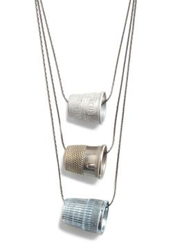 thimble necklace--interesting.  Ideas coming.  Add mini flowers, beads, etc.
