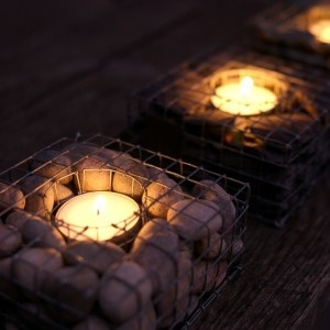 Little gabions with candles inside