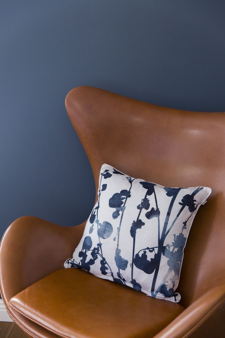Usva Cushion Cover | The Usva pattern reminds of summer mornings and evenings. The beautiful ink blue pattern depicts a silhouette of sorrel, and it is created by designer Liina Harju.