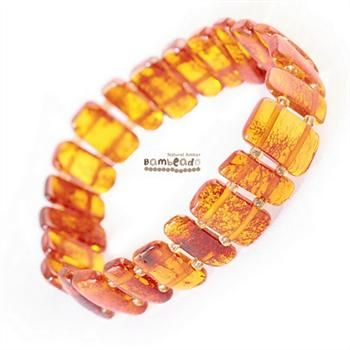 This cognac large pieces bracelet is made from amber stones that have been smoothed so that there are no sharp edges. The bracelets are mounted on double elastic thread and are gorgeous on. Aprrox 18cm in length.While Bambeado amber comes in several colours, the colour is just a matter of personal choice. The colours may vary slightly from the images on the website due to variations in the amber beads. Each amber bracelet is unique.