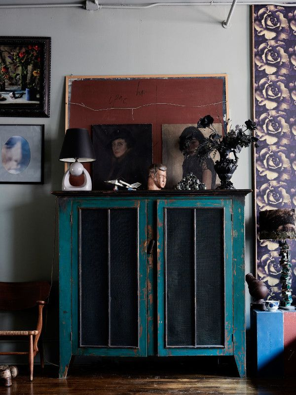 Bedroom details – a farmhouse food store cabinet, vintage lamp, tin airplane, timber bust, sculpture by Dove, black spray-painted silk flowers and Capodimonte vase. Photo – Eve Wilson, production – Lucy Feagins / The Design Files.