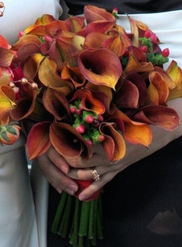 Wedding Flowers, Bridesmaid Bouquet: Rust mini calla lillies and red hypericum. Created by 2 Gals with Flowers in Kansas City, MO.