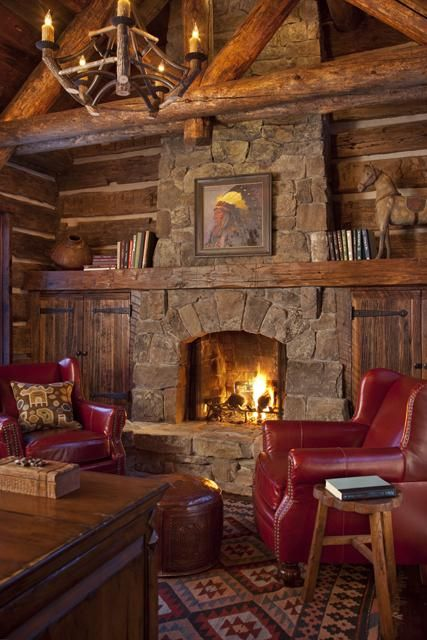 Stone FP.  Love mantle that goes across with cabinetry below.  Rustic log great room with a soaring fire