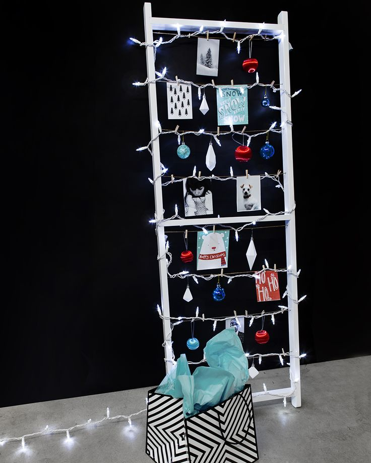 standit photo display from umbra acts as fun alternative christmas tree idea that can stay