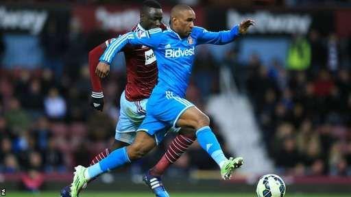 Jermain Defoe runs with possession