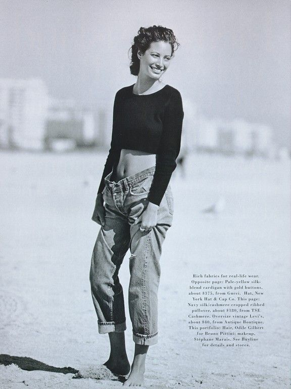 """Christy Turlington """"Little Me"""" by Peter Lindbergh / Harper's Bazaar US / 1993 /  90s style / fashion icons / mom jeans / high waisted denim / blue jeans / oversize jeans / straight cut / sexy / distressed denim / understated cool / casual style / REDUN"""