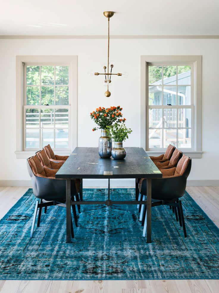 Electric blue rug dark wooden table and