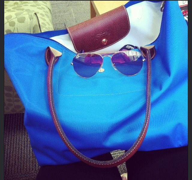 i love that blue longchamp. i hope that that is its real color and not just some filter