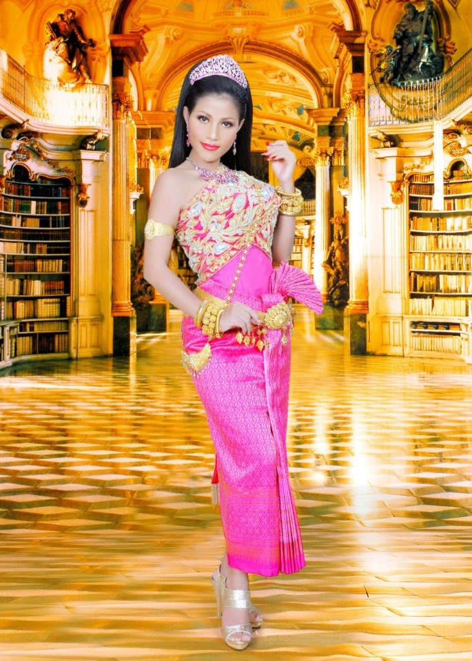 traditional Cambodian wedding dress. love the color too!
