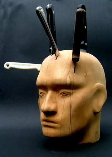 Man head knife holder