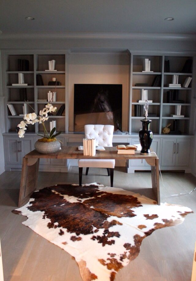 I think an animal rug with a table and chair facing the window like this would be awesome!