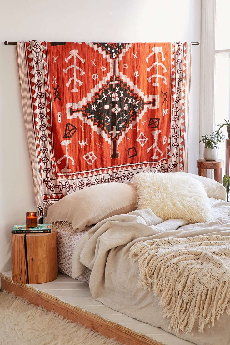 I would love to own that tapestry. I'm loving everything in this picture- the textures, the bedding, the plants and the use of wood. Maybe I can put little stools for potted plants to protect the floor and bring them in the field of vision.
