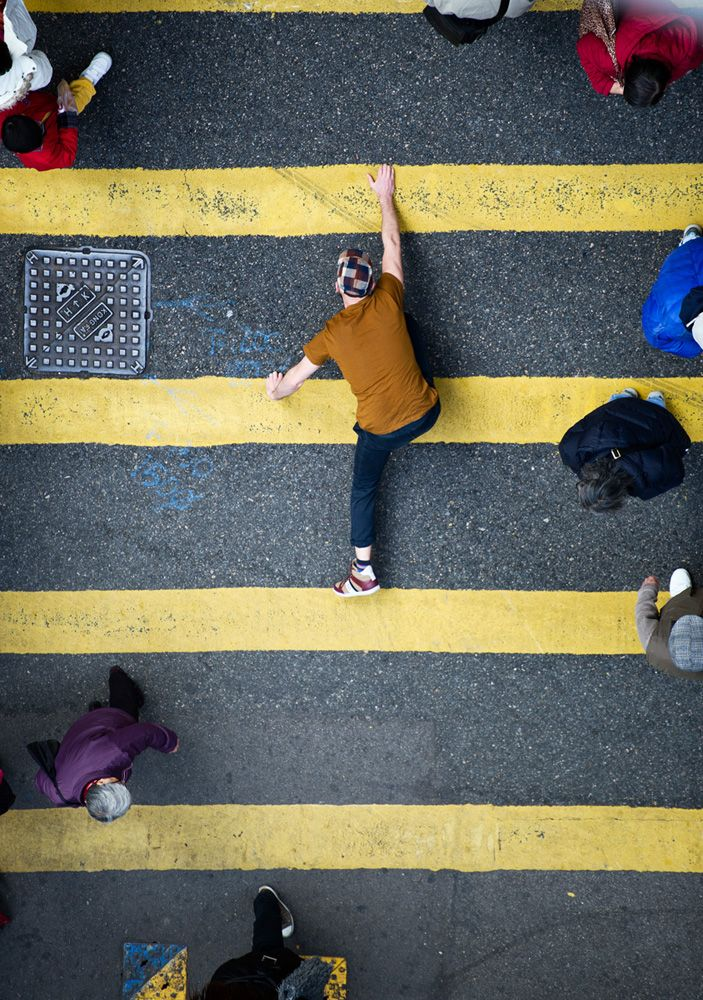 Christian Aslund drew on the spirit of platform games such as Mario for this print advertising campaign for sneaker brand Jim Rickey.  The photographer shot the models in awkward horizontal positions on the streets of Hong Kong, using a telelens to make the images appear flat and the scenes vertical.