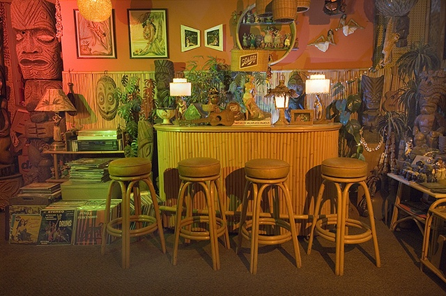 "When the climate didn't allow for outdoor living, the outdoor living went to the basement. Tiki bars transformed the lower level of the home into a ""tropical"" paradise."