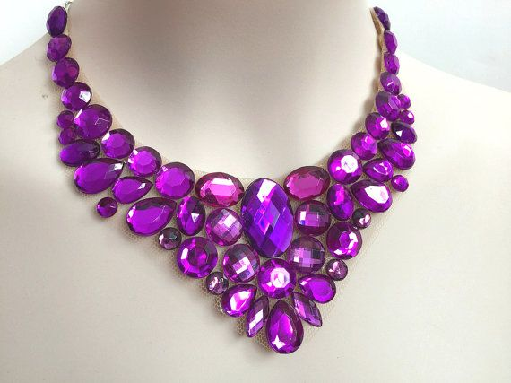 bib purple rhinestone necklace I made this unique bib necklace with purple color acrylic rhinestones, each rhinestone is glued on sheer netting and each rhinestone has a piece of tan color soft felt on the back side for comfort when you wear it, ( PLEASE CHECK PICTURES ) also it is has