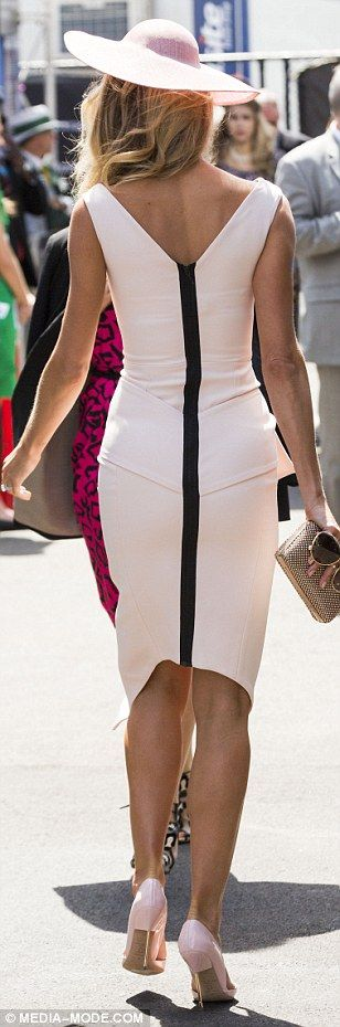 Pretty in pink: The former Miss Universe teamed her pale pink frock with an elegant blush-coloured hat