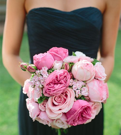 Pink bouquet with navy bridesmaid dresses