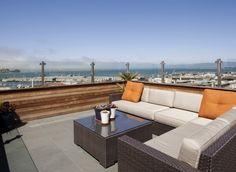 windschutz terrasse glas holz geländer rattan lounge möbel sofa