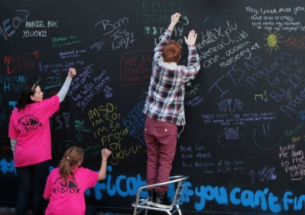A team of young volunteers dressed in flourescent pink to drum up interest in Towcester Vision Youth Cafe's latest project to create a wall of song lyrics.