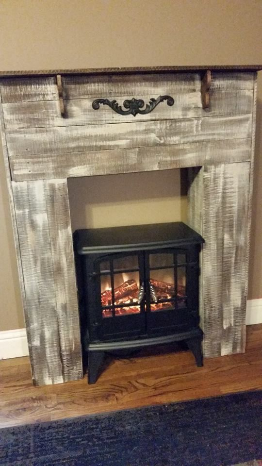 """RECYCLED WOOD PALLETS:  This is our Faux Fireplace to go with the """"Faux"""" weather we are having. I have always wanted a fireplace in my bedroom, now I have one. It is 47"""" high x 36.5"""" wide x 10"""" deep. The opening is 20.5 wide x 33"""" high. We can build one to your specifications, just send us a message. We are selling them for $100 """"naked"""" and $125 painted/stained. This one is white-washed with a stained mantle. (The small floor heater is not included.) Item # 540"""