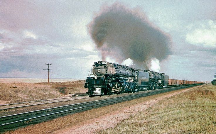 Union Pacific steam locomotives, Challenger 4-6+6-4 # 3941 & Big Boy 4-8+8-4 # 4024, are seen hauling a freight train at Borie, Wyoming, 05-14-1953