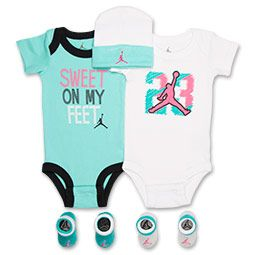 "<p>Tiny Jordan fans can dress just like their hero in the Girls' Infant Jordan 23 5-Piece Set. This adorable five-piece set has everything you need to give your baby iconic Jordan style.</p><p>Featuring a mini Jumpman jersey onesie and one with the iconic ""JORDAN 23"" screen-printed on the front, this tiny set comes equipped with two pairs of matching booties and a cap. The stretchy, soft cap features the Jordan Jumpman logo, while the coordinating booties are an easy-on, easy-off style…"