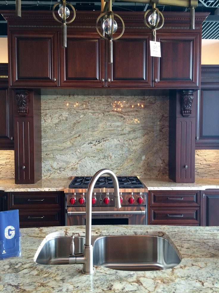 Beautiful Typhoon Bordeau Granite Backsplash! One of the many beautiful Granite Displays you can see @Station12