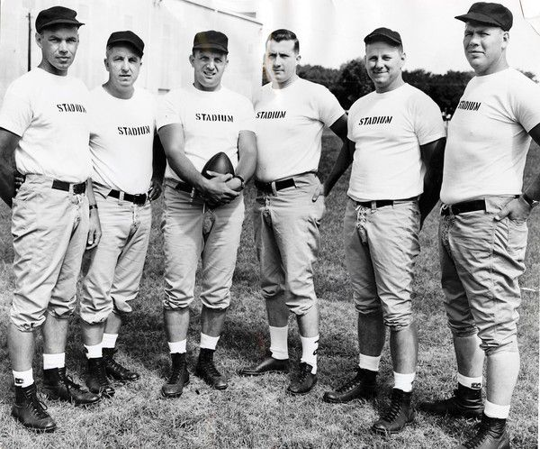 Northwestern University head football coach Lou Saban is seen with the rest of his staff on August 31, 1955. Left to right: Bud Svendsen (line coach); Al Pesek (backfield coach); Lou Saban;