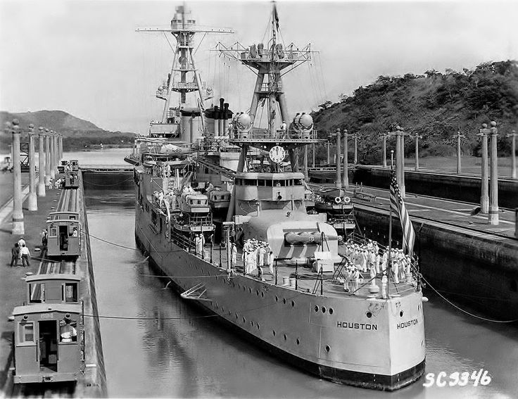 USN; USS Houston, a Northampton class Heavy Cruiser in the locks on the Panama Canal c/w the Electric donkeys.