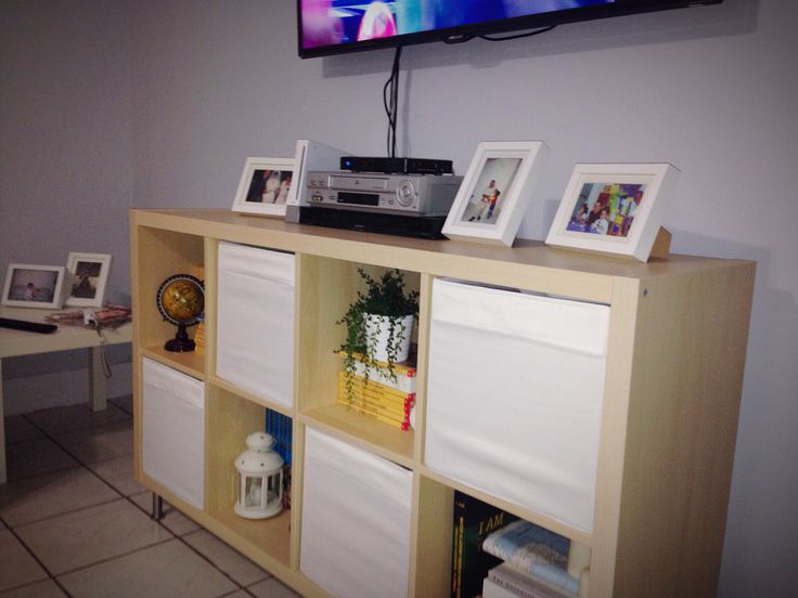 use ikea 39 s kallax shelving unit and some dr na boxes for a cheap tv stand bookshelf home. Black Bedroom Furniture Sets. Home Design Ideas