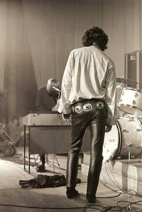 leather pants and a concho belt..