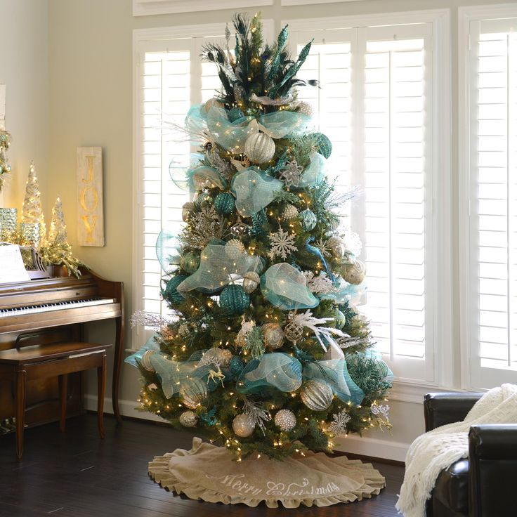 With silver and sparkles, metallic and teal, this tree is full of glitz and glam! It features snowflake ornaments, beaded balls, peacock feathers, champagne ribbon and more!