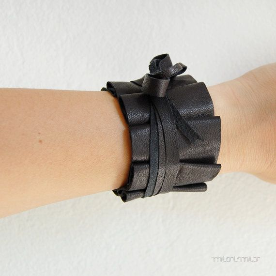 Fashion elegant effeminate bracelet. Black pleated recycled leather with bow, silver colored toggle fastener. Ready to ship.