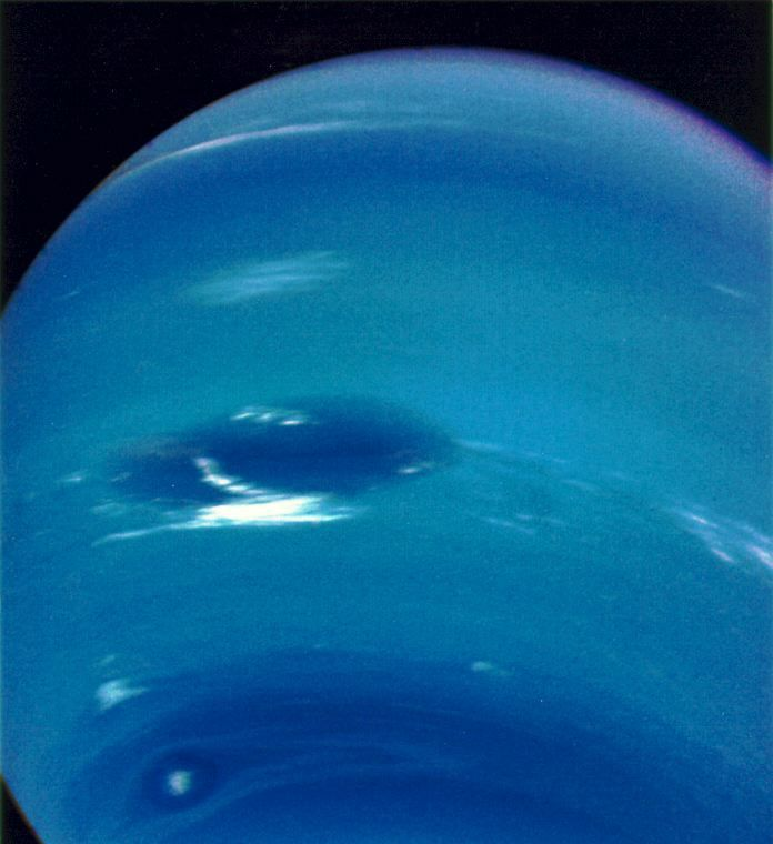 It shows surface features that are somewhat like those of Jupiter, with a Great Dark Spot showing during the 1989 Voyager 2 flyby along with visible bands and clouds. Later, in 1994, the Hubble Space Telescope did not see the spot but found a similar one in the other hemisphere.