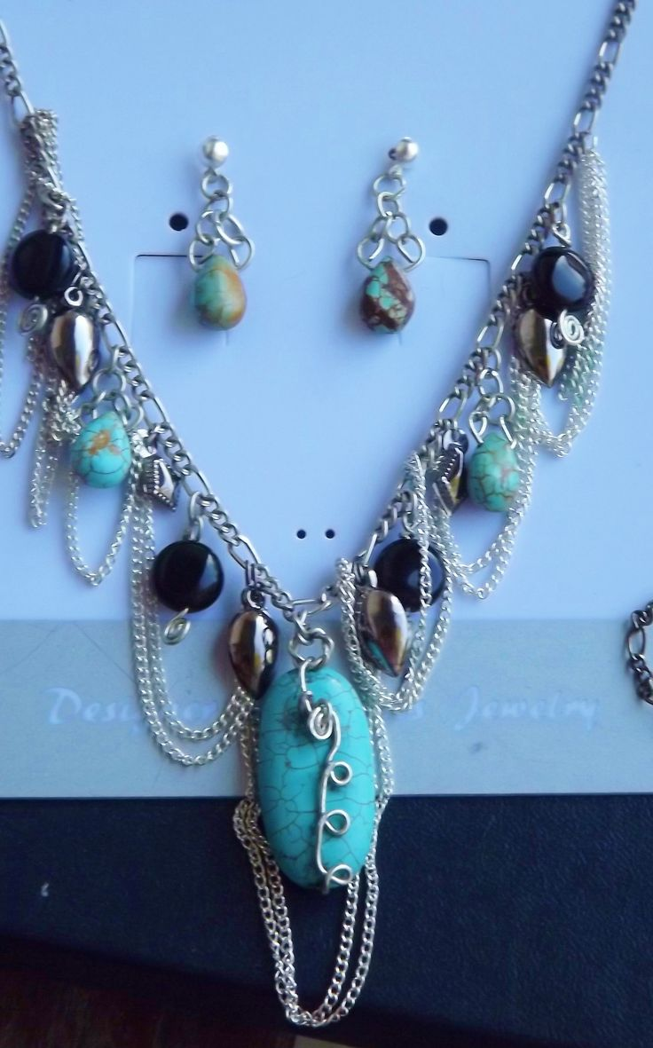 This+is+a+handmade+set+featuring+genuine+turquoise+and+black+onyx,+set+in+silver+plate+qnd+black+metal.+It+is+a+one+of+a+kind+and+it+has+a+ajustable+chain+so+that+it+can+be+16+-+22+inches+long.+The+earrings+are+silver+plated+posts+with+hand+made+wire+work.+