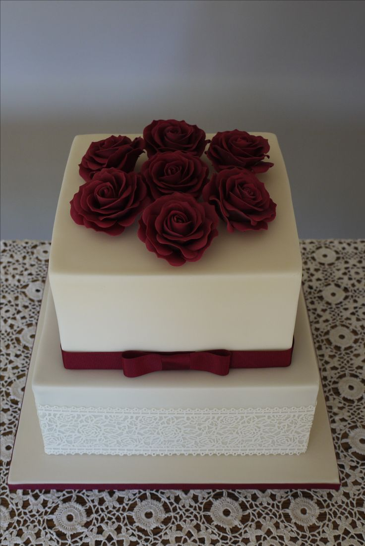 Wedding cake with hand made burgundy sugarpaste roses