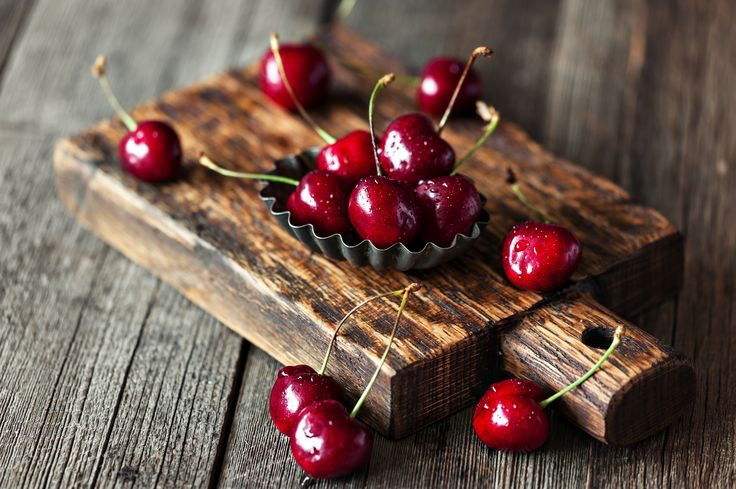 Sweet cherry on a wooden Board