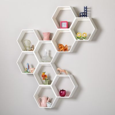 "When designing these shelves, we thought it was a great idea to make them a unique shape that can be oriented in any direction.  We thought it was a bad idea to include a complimentary bee colony. Details, details Nod exclusive Features three connected hexagonal shelves Each shelf is 4"" deep and 11. 5""W x 10""H Hang multiple shelves to form a giant honeycomb shelving unit Can hold up to 50 lbs."