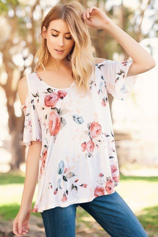 This beautiful floral print top is a blend of rayon and spandex for ultimate comfort. It has a loose, flowy fit with an open shoulder for some extra style!