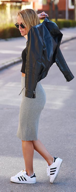 Black leather jacket with gray pencil skirt.