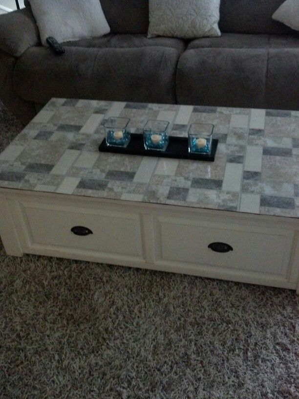 Add peal and stick floor tiles on an old beat up table top