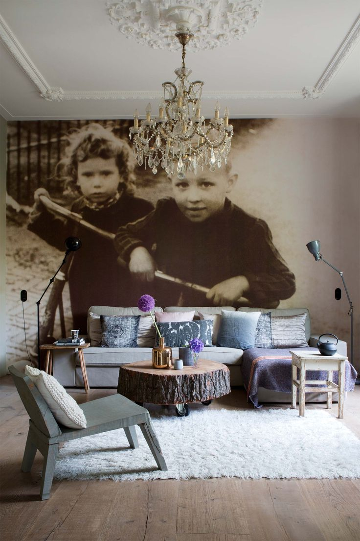 Amazing living room idea with grey sofa, classic chandelier, industrial style coffee table on wheels and white rug