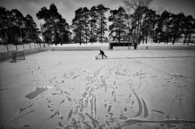 Sports, 1st prize stories. Players of an amateur hockey team in provincial Russia before, during and after a game in the regional championship in Vetluga, Nizhny Novgorod Oblast, Russia. In this photograph, Evgeny Solovyov, head coach of HC Vetluga prepares the stadium for the match in Vetluga, Russia, Feb. 19, 2015.
