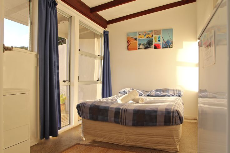 Tourist Flat | Russell-Orongo Bay Holiday Park.  Double bedroom is located off main living area with small kitchenette and access to the en-suite bathroom.