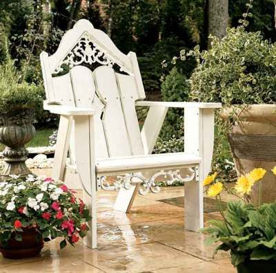 My all time favorite garden chair.  If only I could find a set of plans similar to it so I could build it myself...