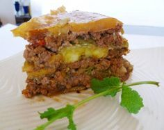 Hispanic Kitchen — Piñón (Puerto Rican Lasagna). Ingredients: picadillo, plantains, French-style string beans, ground beef, olive oil, onion, red bell pepper, sofrito, Sazón Goya, Spanish tomato sauce, garlic, salt and pepper.