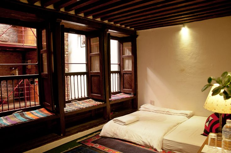 Small single bed and window to view inner space, courtyard. #Patan #Nepal #interior #Architecture #CosyNepal #Nepali #Newari #renovated #Dhakwa house