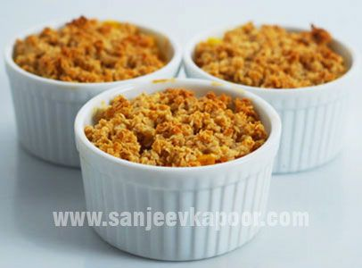 Mango Pineapple Oats Crumble Recipe - Mango and pineapple cubes covered with oats and honey and baked.