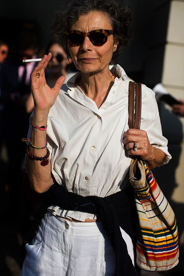effortless: start with white; keep it loose; don't tuck; add a little color with bag and bracelets; break it up with a sweater tied around waist (laid-back way to give the outfit some shape without tucking-in or wearing a belt); hair back; killer sunglasses