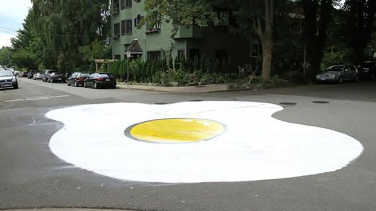 Giant painted egg in Kits intended to slow traffic - YP NextHome